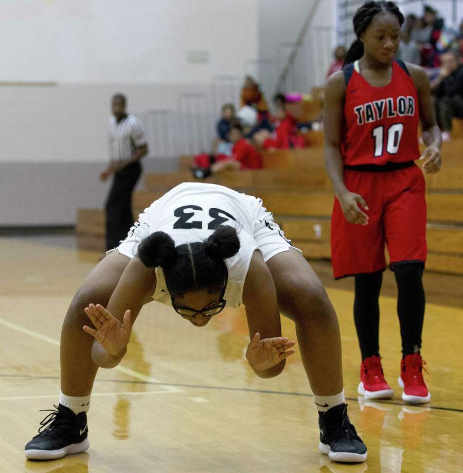 Conroe guard Jade Traylor (33) slaps the court after forcing a turnover by Alief Taylor guard Kierra Wright during the fourth quarter of a non-district high school girls basketball game at Conroe High School, Tuesday, Nov. 20, 2018, in Conroe. Photo: Jason Fochtman, Houston Chronicle / Staff Photographer / © 2018 Houston Chronicle