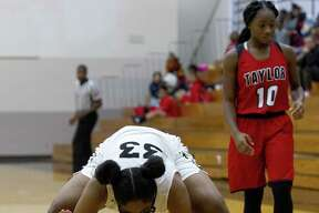 Conroe guard Jade Traylor (33) slaps the court after forcing a turnover by Alief Taylor guard Kierra Wright during the fourth quarter of a non-district high school girls basketball game at Conroe High School, Tuesday, Nov. 20, 2018, in Conroe.