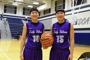 Jersey Village's Kayleigh Truong, left, and her twin sister Kayleigh (15) signed their National Letter of Intent to the University of Gonzaga to play basketball.