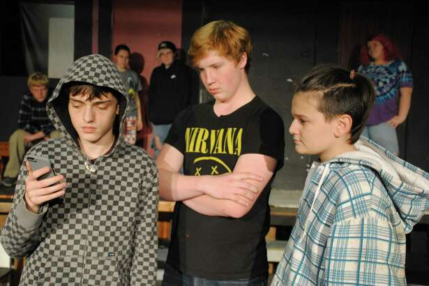 From left are Hunter Allis, Caleb Ripper and Hunter Soltanpanah. In the background is Timmy Thompson, Mary Rainville, Finn Russell and Haley Steyer.