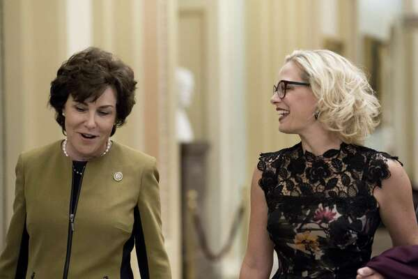 Reps. Jacky Rosen, D-Nev., left, and Kyrsten Sinema, D-Ariz., both incoming senators, arrive on Capitol Hill in Washington, Nov. 13, 2018. Sinema will do what she must to advance.