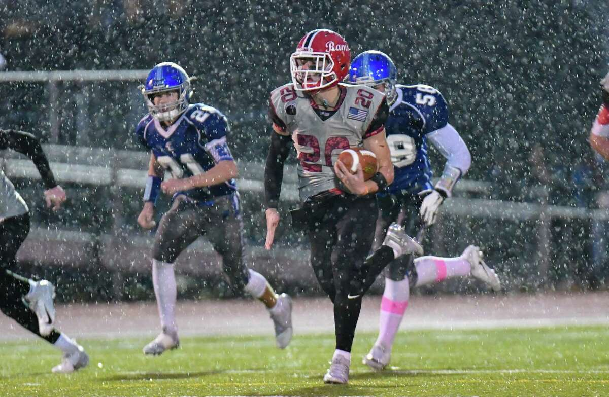 New Canaan's Quintin O'Connell goes 70 yards for a touchdown against Fairfield Ludlowe on Nov. 9.