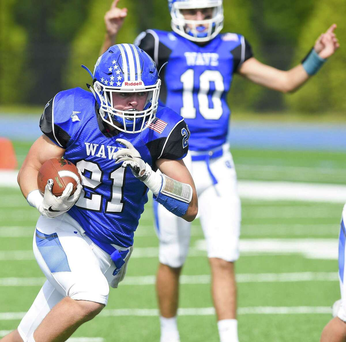 Darien's Will Kirby carries the ball in for a touchdown during the first half against Stamford on Sept. 29.