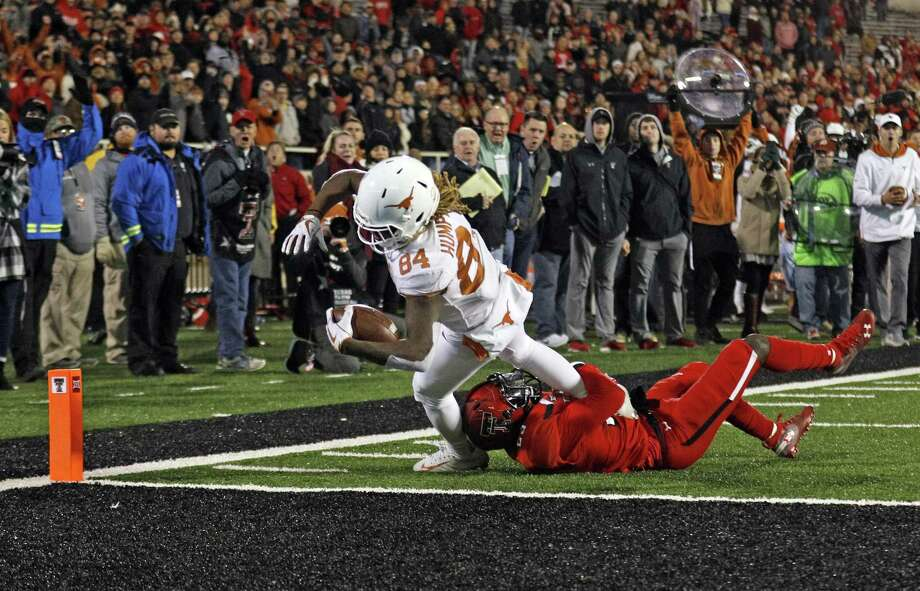 Texas' Lil'Jordan Humphrey scores the game-winning touchdown against Texas Tech's Demarcus Fields in the Longhorns' 41-34 victory in Lubbock. Photo: Brad Tollefson, FRE / Associated Press / Copyright 2018 The Associated Press. All rights reserved.