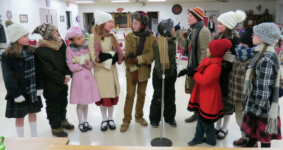 """Some of the cast pose in costume ahead of Curtain's Up Theater Company's production of """"A Christmas Story."""" The show is set to begin next week at the Wildey Theatre. Photo: For The Intelligencer"""
