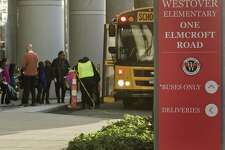 Children line up for the busses at the end of the day at the new Westover at Elmcroft campus. Tuesday, Nov. 20, 2018