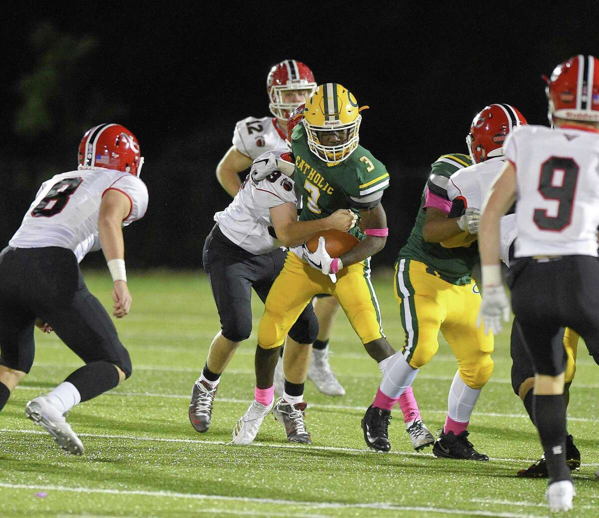 Trinity Catholic's Tahj Morgan carries the ball against New Canaan on Oct. 19.