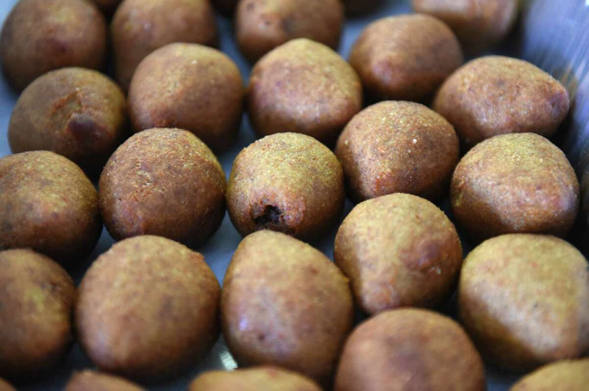 Cooked kibbeh is seen on a baking sheet as Syrian refugee women who started a catering business to support their families make their latest order for Thanksgiving at the Sister Maureen Joyce Center on Tuesday, Nov. 20, 2018 in Albany, N.Y. (Lori Van Buren/Times Union)