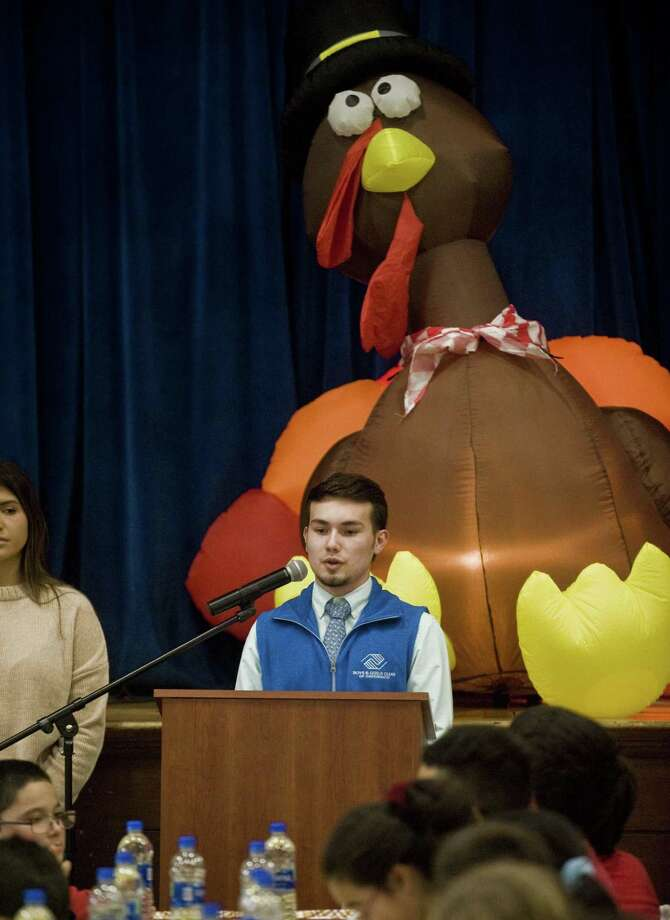 Marvin Campos, a senior at Stamford High School, gives the blessing at the annual Thanksgiving dinner held at the Boys & Girls Club of Greenwich on Tuesday. Photo: Scott Mullin / For Hearst Connecticut Media / The News-Times Freelance
