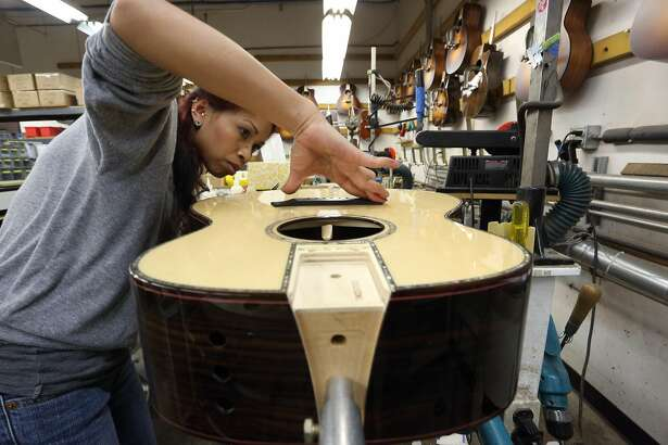 Building instruments at Taylor Guitars.