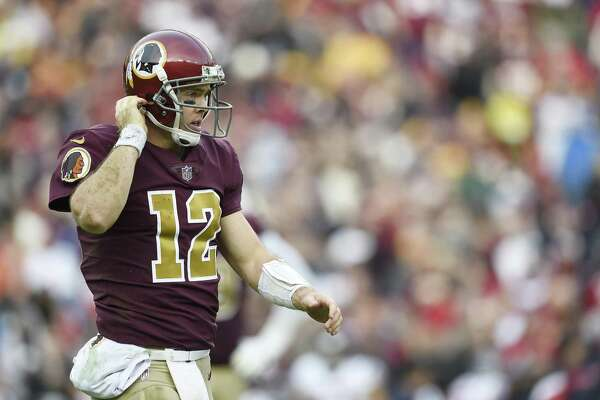 LANDOVER, MD - NOVEMBER 18: Colt McCoy #12 of the Washington Redskins walks to the sideline in the fourth quarter against the Houston Texans at FedExField on November 18, 2018 in Landover, Maryland. (Photo by Patrick McDermott/Getty Images)
