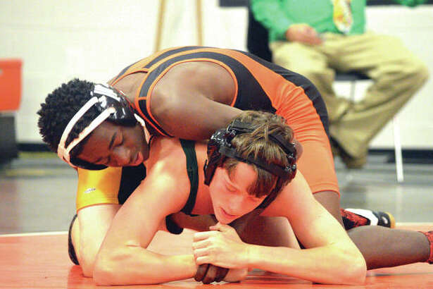 Edwardsville's Jordan Johnson, top, wrestles Metro-East Lutheran's Jakob Schroeder in a 126-pound match on Tuesday at Jon Davis Wrestling Center.
