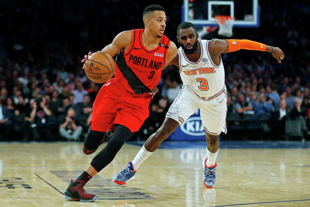 Portland Trail Blazers guard CJ McCollum (3) drives to the basket past New York Knicks guard Tim Hardaway Jr. (3) during the second half of an NBA basketball game Tuesday, Nov. 20, 2018, in New York. The Trail Blazers defeated the Knicks 118-114. (AP Photo/Adam Hunger)