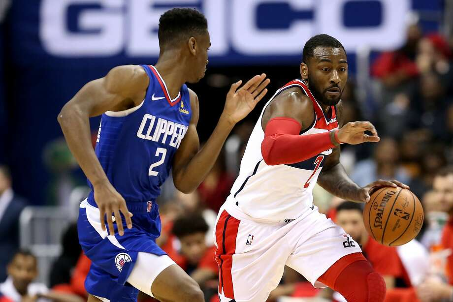 John Wall (right) of the Wizards, dribbling past Shai Gilgeous-Alexanderof the Clippers, during the second half at Capital One Arena on November 20, 2018 in Washington, DC. NOTE TO USER: User expressly acknowledges and agrees that, by downloading and or using this photograph, User is consenting to the terms and conditions of the Getty Images License Agreement. (Photo by Will Newton/Getty Images) Photo: Will Newton / Getty Images