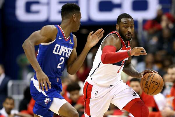WASHINGTON, DC - NOVEMBER 20: John Wall #2 of the Washington Wizards dribbles past Shai Gilgeous-Alexander #2 of the LA Clippers during the second half at Capital One Arena on November 20, 2018 in Washington, DC. NOTE TO USER: User expressly acknowledges and agrees that, by downloading and or using this photograph, User is consenting to the terms and conditions of the Getty Images License Agreement. (Photo by Will Newton/Getty Images)
