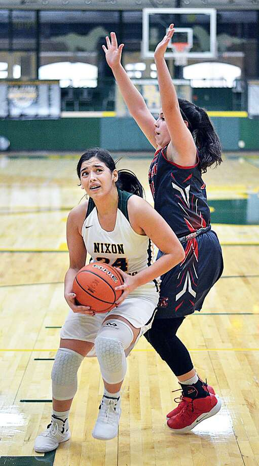 Ashley Pena had 21 points leading the Lady Mustangs to a dominant 63-37 victory over Sharyland Pioneer Tuesday afternoon. Photo: Cuate Santos /Laredo Morning Times / Laredo Morning Times