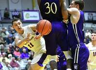 University at Albany's Cameron Healy passes the ball under the hoop during a basketball game against Holy Cross at the SEFCU Arena on Tuesday, Nov. 20, 2018 in Albany, N.Y. (Lori Van Buren/Times Union)