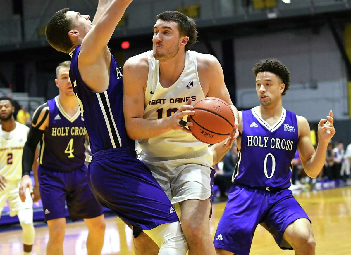 University at Albany's Brent Hank is guarded by Holy Cross' Matt Faw as he drives to the hoop during a basketball game against Holy Cross at the SEFCU Arena on Tuesday, Nov. 20, 2018 in Albany, N.Y. (Lori Van Buren/Times Union)