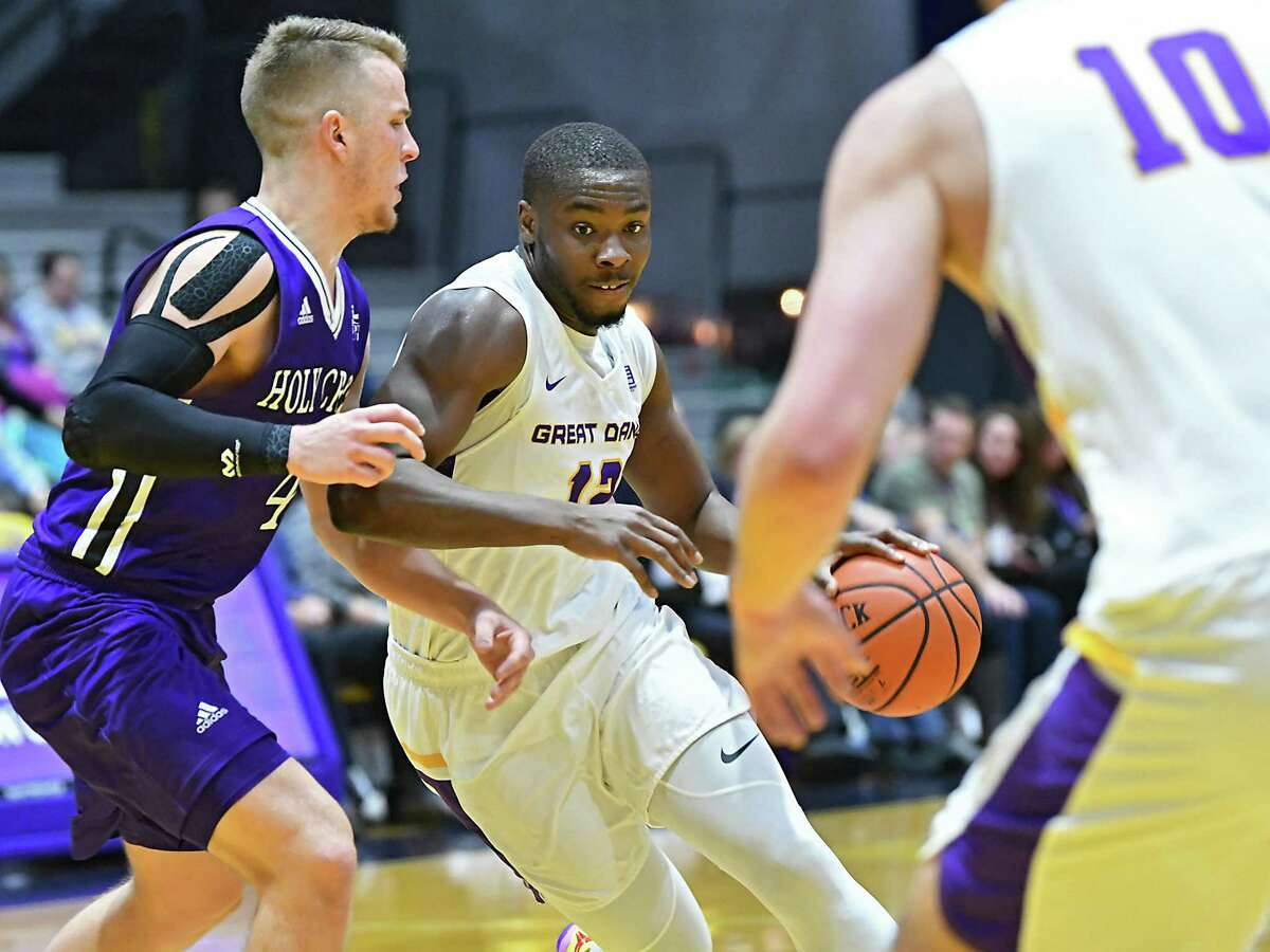 University at Albany's Devonte Campbell is guarded by Holy Cross' Austin Butler as he drives to the hoop during a basketball game against Holy Cross at the SEFCU Arena on Tuesday, Nov. 20, 2018 in Albany, N.Y. (Lori Van Buren/Times Union)