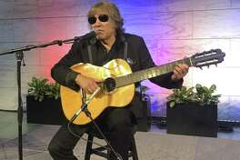 """Grammy Award-winning artist Jose Feliciano performs the ?""""Star-Spangled Banner?"""" at the Smithsonian?' National Museum of American History in Washington, Thursday June 14, 2018. Feliciano also donated objects reflecting his international career to the museum. (AP Photo/Luis Alonso Lugo)"""