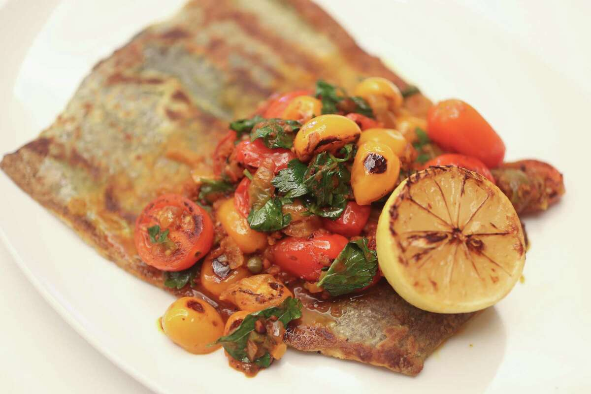 Indianola Rainbow Trout with tomato and achiote salsa.