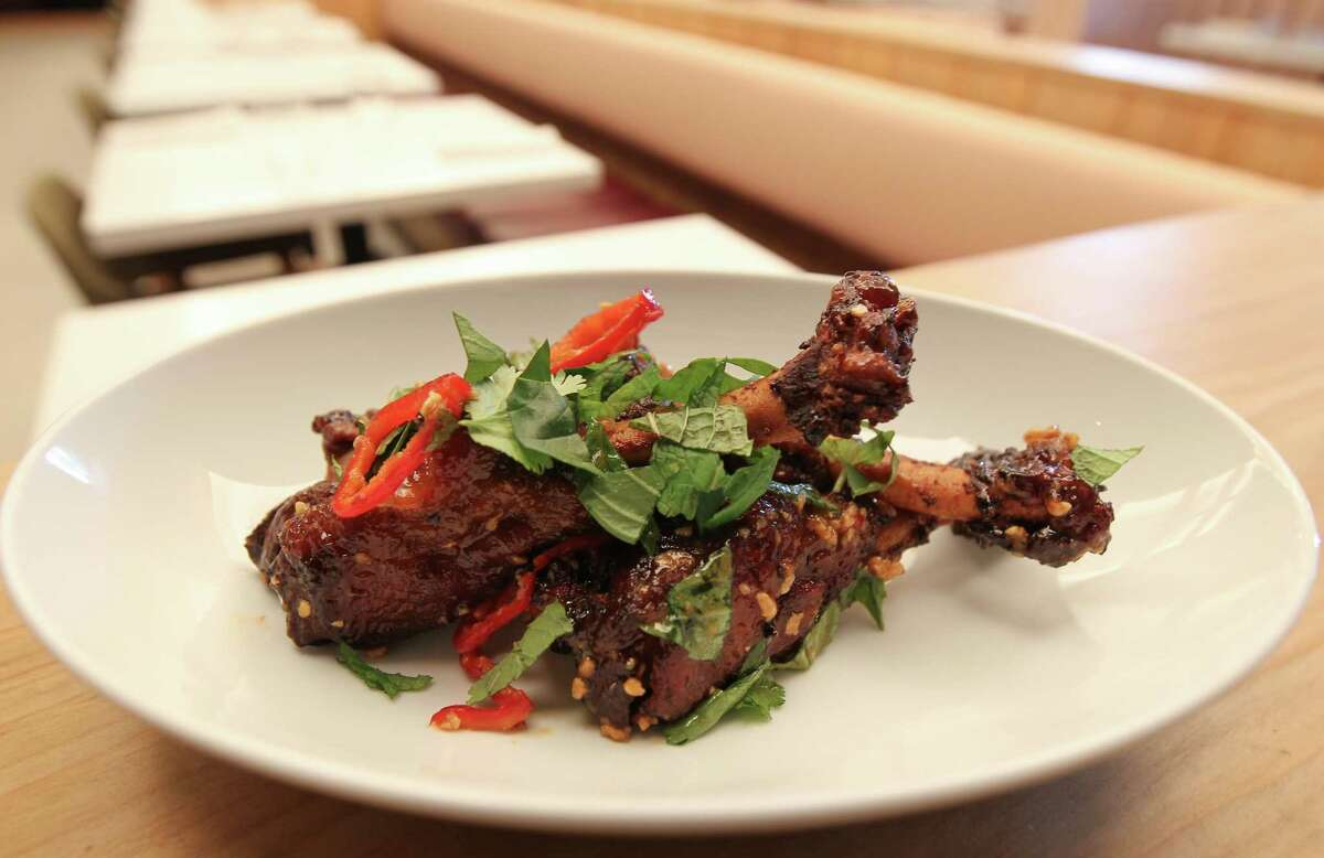 Crispy duck wing with garlic, Fresno chile and herbs at Indianola.