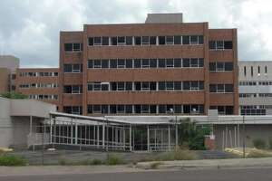 The property owner of the Mercy hospital property has struck a deal with a Houston investment group to turn the building into World Free Trade Plaza.