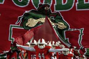 The Woodlands running back Jacoby Clarke (44) leads the team onto the field before a Region II-6A (Div. I) bi-district playoff football game at Woodforest Bank Stadium, Friday, Nov. 16, 2018, in Shenandoah.