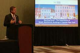 Thomas McGrath, senior vice president and director of Upstate Revitalization at the Community Preservation Corporation, led a panel discussion Tuesday in Albany about small multifamily rental properties. (Photo provided)