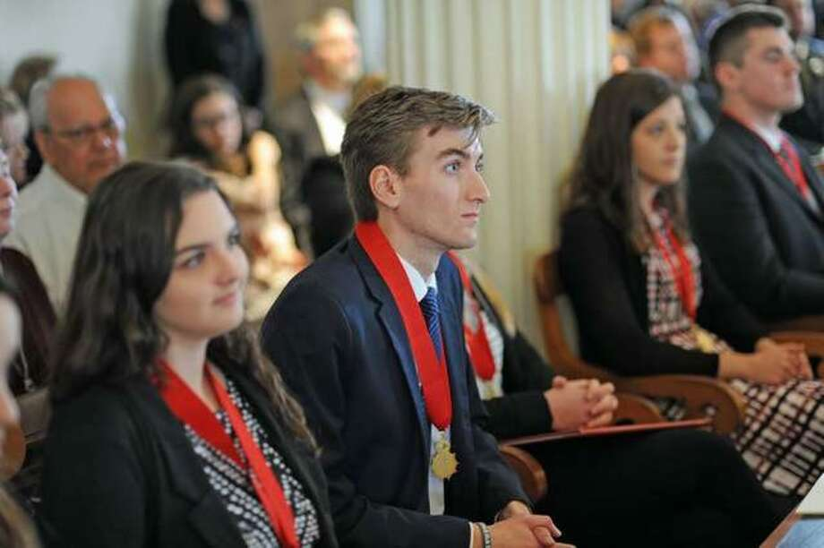 SIUE's Austin Tuttle (center), during the Lincoln Academy Student Laureate ceremony in Springfield. Photo: For The Telegraph