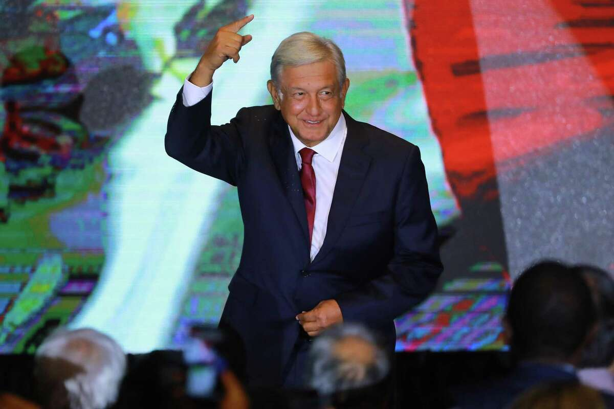 MEXICO CITY, MEXICO - JULY 01: Andres Manuel Lopez Obrador points in the direction to the Zocalo after giving a speech for his virtual victory for the presidency of Mexico at his party media center as part of the Mexico 2018 Presidential Election at Hilton Hotel on July 1, 2018, in Mexico City, Mexico. (Photo by Eloisa Sanchez/Getty Images)