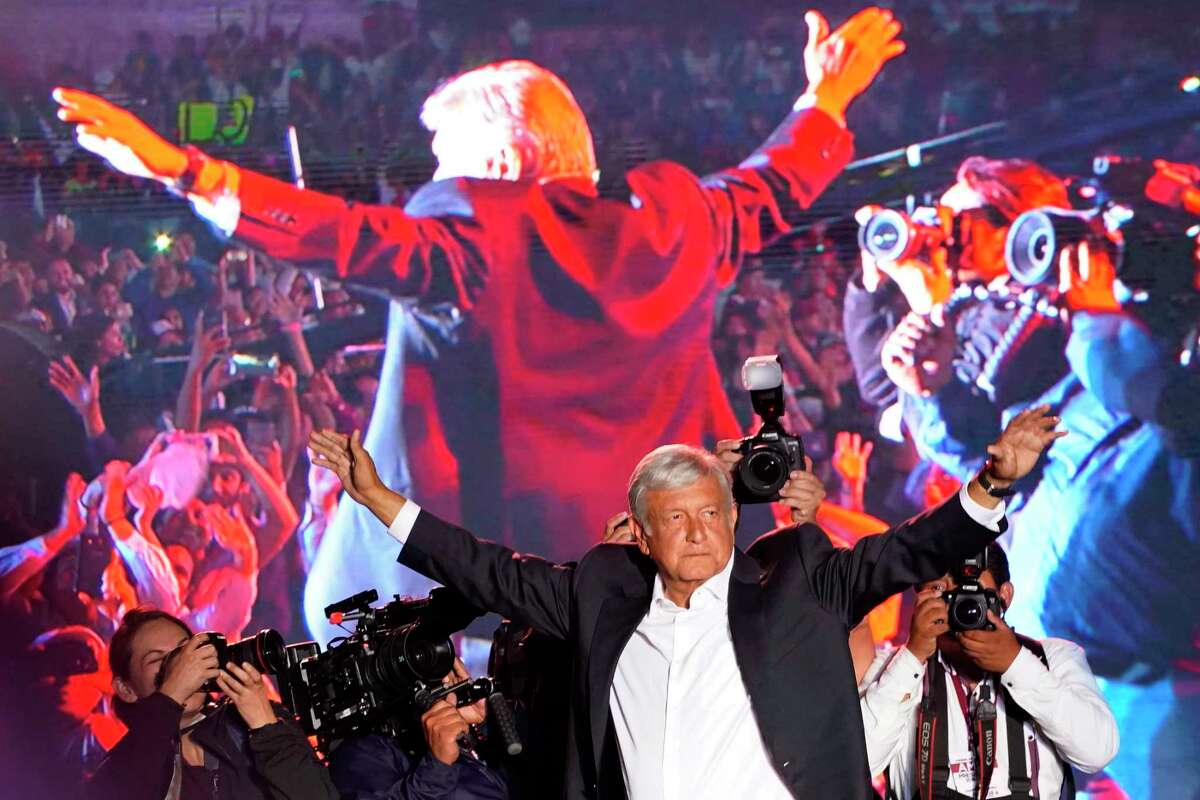 In this Wednesday, June 27, 2018 photo, presidential candidate Andres Manuel Lopez Obrador waves to supporters at his closing campaign rally in Mexico City.