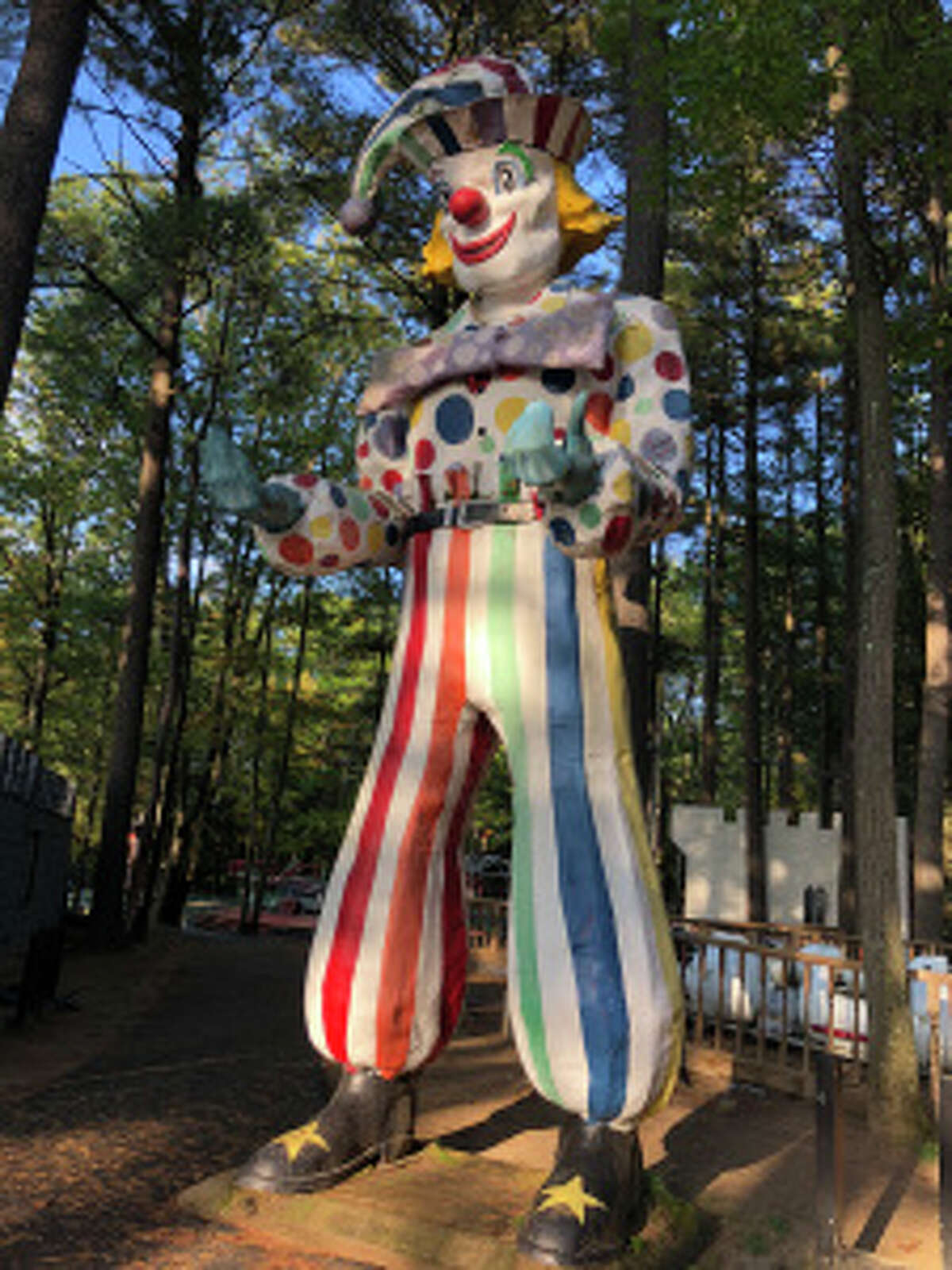 A statue of a clown is among the items for sale from Magic Forest in Lake George.