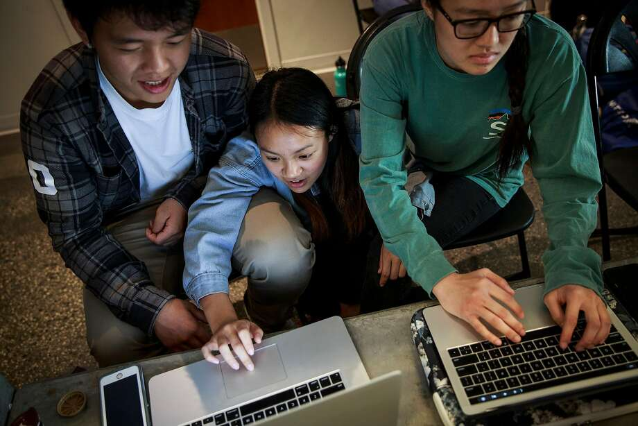 UC Berkeley students Haitao Zhang (left) Ingrid Wu and Emily Hu show off their skills at the Cal Hacks competition. Many of the young engineers said they would avoid taking jobs at Facebook. Photo: Photos By Max Whittaker / New York Times