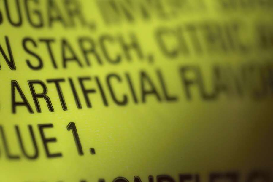 Labels, like this one on candy, often list artificial flavors, which could refer to thousands of ingredients. Photo: Patrick Sison / Associated Press