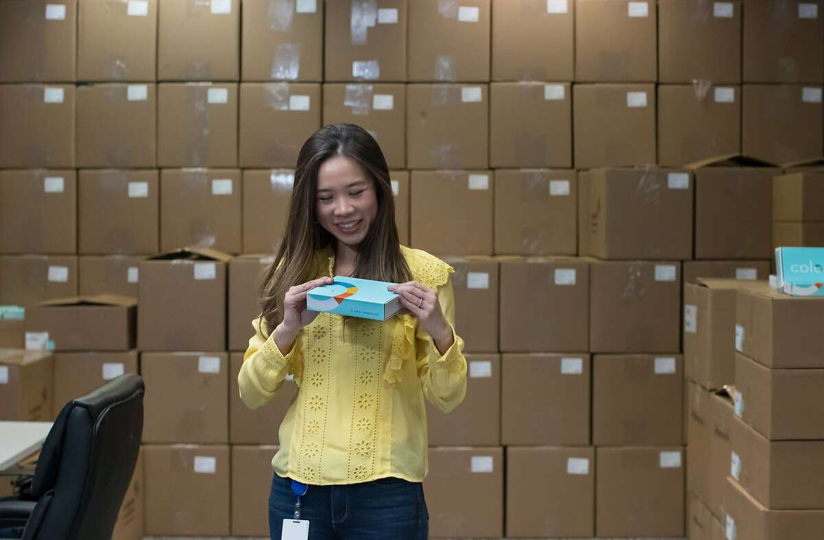 Linda Jiang, head of consumer marketing at Color Genomics, looks at a kit from among the boxes ready to ship on Tuesday, Nov. 20, 2018, in Burlingame, Calif.