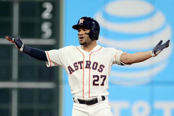 HOUSTON, TX - OCTOBER 17: Jose Altuve #27 of the Houston Astros reacts to a fan interference call in the first inning during Game 4 of the ALCS against the Boston Red Sox at Minute Maid Park on Wednesday, October 17, 2018 in Houston, Texas. (Photo by Loren Elliott/MLB Photos via Getty Images)