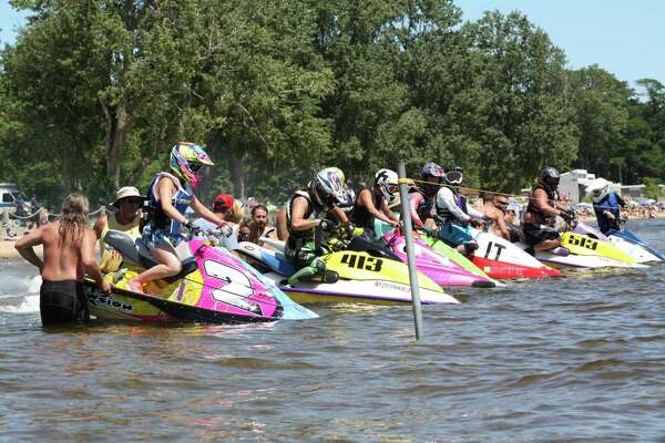 Rylee Grace O'Flaherty of Rotterdam is shown in the foreground (2) at the start of a Jet Ski Watercross race in 2017. She competes against men and women of all ages in the the novice division. The skis travel up to 50 miles per hour. (Courtesy Melvin Marsh photography)