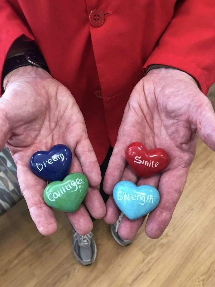Volunteers at the Smilow Cancer Hospital Care Center in Torrington are often cancer survivors themselves. Cancer survivor Geoffrey Muggleton gives patients healing rocks with inspiring words painted on them when he visits. Photo: Renee Gaudette / Contributed Photo /