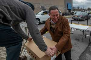 Local businessman Roddy Valente assists with the unloading of turkeys that will be given to those in need outside the Capital OTB  Wednesday Nov. 21, 2018 in Albany, N.Y.  (Skip Dickstein/Times Union)