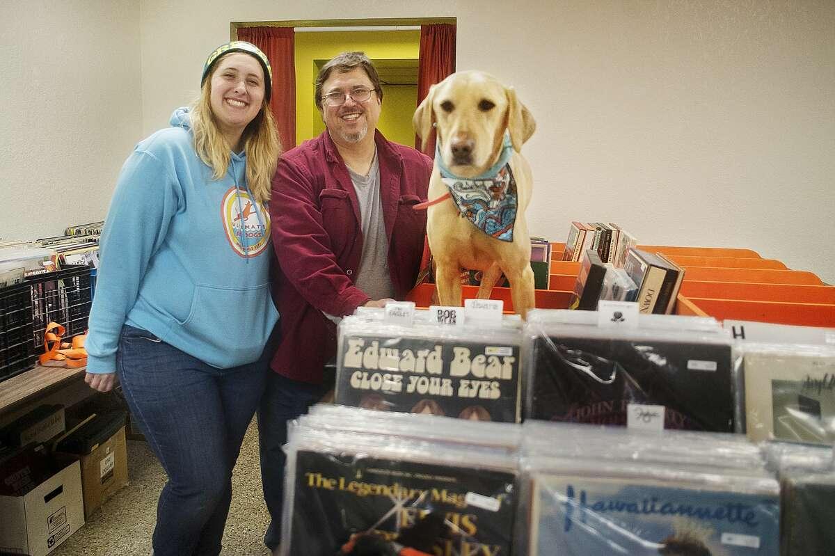 Katie Gleason, left, Jim Gleason, center, and their dog Blue pose for a portrait inside their record store, Radio Wasteland, on Tuesday in Midland. (Katy Kildee/kkildee@mdn.net)