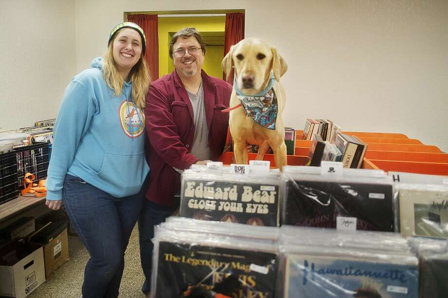 Katie Gleason, left, Jim Gleason, center, and their dog Blue pose for a portrait inside their record store, Radio Wasteland, on Tuesday in Midland. (Katy Kildee/kkildee@mdn.net) Photo: (Katy Kildee/kkildee@mdn.net)