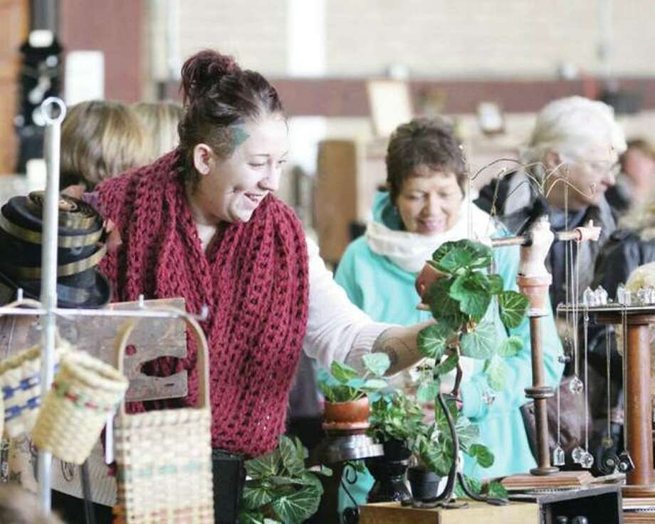 In this 2016 file photo, Amanda Herron, of Alton, looks at an item at the 14th annual Green Gift Bazaar at the YWCA of Alton. Alton Main Street and the Sierra Club sponsored the event held in conjunction with Small Business Saturday. Photo: Scott Cousins | Telegraph File Photo