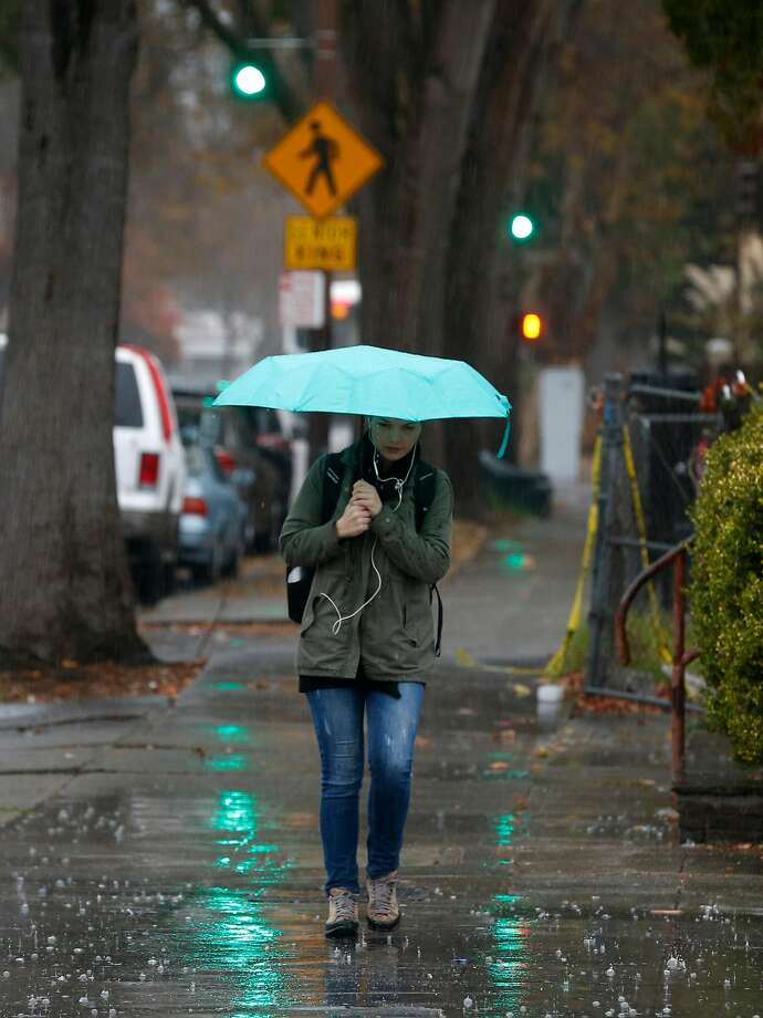 A woman walks in the rain on Sixth Street during the first significant rainstorm of the season in Berkeley, Calif. on Wednesday, Nov. 21, 2018. Photo: Paul Chinn, The Chronicle