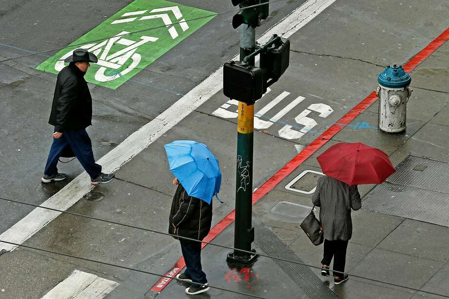 People make their way through downtown San Francisco in the rain on Wednesday, Nov. 21, 2018, in San Francisco, Calif. Photo: Santiago Mejia / The Chronicle