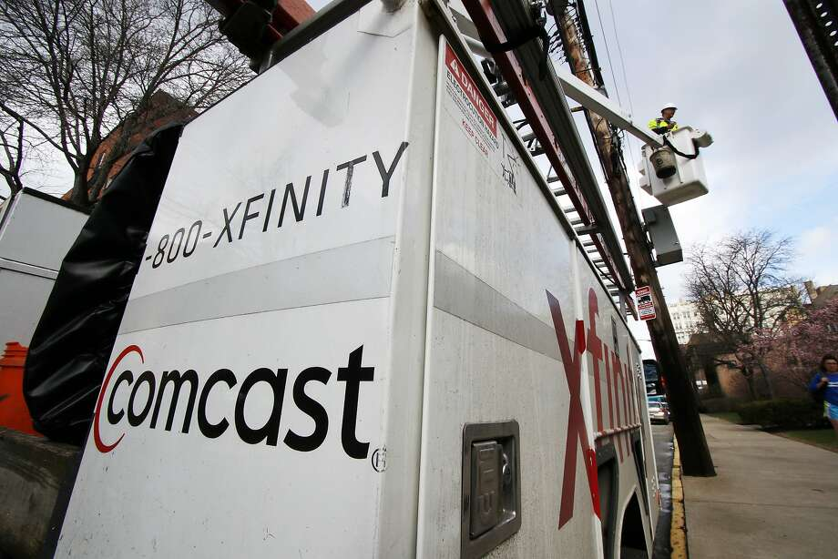 FILE- In this March 27, 2017, file photo, a Comcast worker performs work in Pittsburgh. Comcast Corp. reports earnings Thursday, Oct. 25, 2018. (AP Photo/Gene J. Puskar, File) Photo: Gene J. Puskar, Associated Press