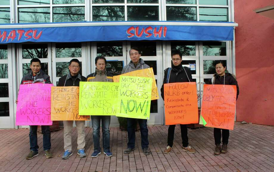 Former Matsu Sushi employees picket outside the restaurant on Nov. 19 in protest of Matsu's labor practices. Photo: Sophie Vaughan / Hearst Connecticut Media / Westport News