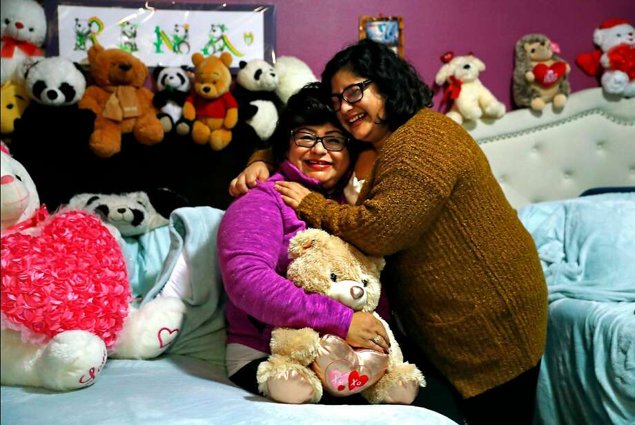 Dora Castillo (left) and daughter Rina, at their S.F. home, say that help 16 years ago still impacts their lives. Photo: Scott Strazzante / The Chronicle