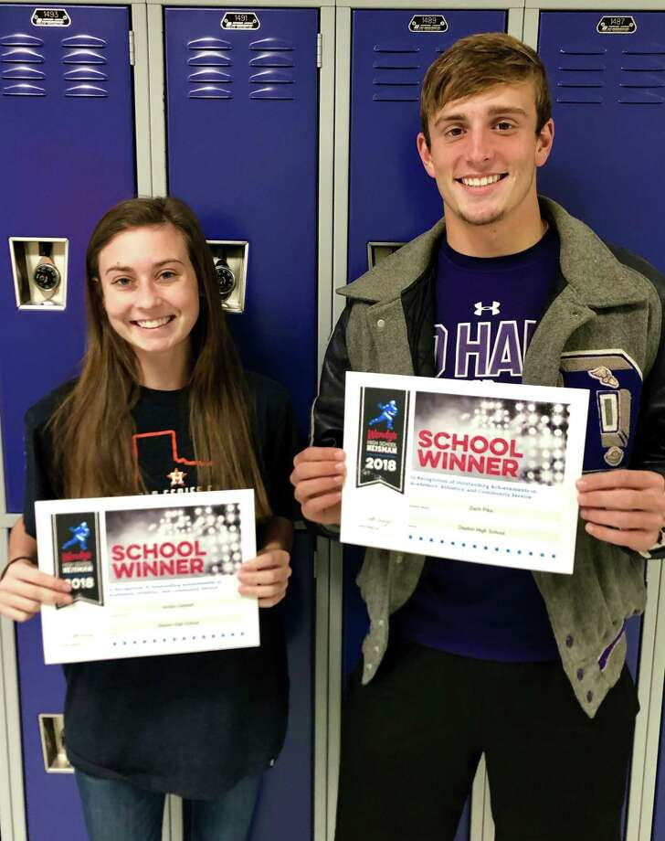 Jordan Cantrell and Zach Pike show the certificates they received for being honored as a School Winner in the Wendy's High School Heisman scholarship contest. Photo: Submitted