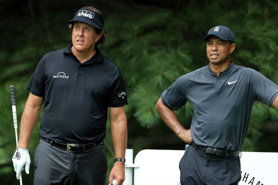 AKRON, OH - AUGUST 01: Phil Mickelson (L) and Tiger Woods meet during a preview day of the World Golf Championships - Bridgestone Invitational at Firestone Country Club South Course at on August 1, 2018 in Akron, Ohio. (Photo by Sam Greenwood/Getty Images) Photo: Sam Greenwood / Getty Images / 2018 Getty Images